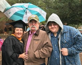 Online MSN graduate Tammy Hussey at graduation with her family